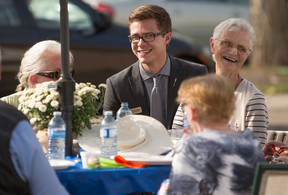 Jon Carson, Edmonton-Meadowlark MLA, visits with his constituents including Jean Bach, right, at Jasper Place Continuing Care Centre during a 50th anniversary celebration of the centre in Edmonton on August 27, 2015. (Photo by Ryan Jackson / Postmedia)