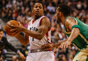 Guard Kyle Lowry (left) led the Raptors with 32 points against the Celtics in Toronto's 105-91 victory at the Air Canada Centre on Friday, March 18, 2016. (Dave Thomas/Toronto Sun)