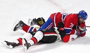 Montreal Canadiens defenceman P.K. Subban falls on Ottawa Senators right winger Bobby Ryan during third-period action at Bell Centre in Montreal on Dec. 12, 2015. (Jean-Yves Ahern/USA TODAY Sports)