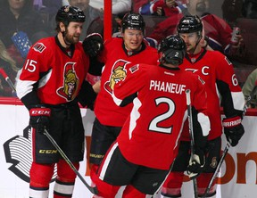 Ottawa Senators right winger Curtis Lazar celebrates his second-period goal against the Montreal Canadiens with teammates at Canadian Tire Centre in Ottawa on March 19, 2016. (Jean-Yves Ahern/USA TODAY Sports)