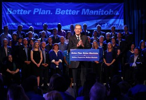 Surrounded by his party's candidates, Leader Brian Pallister delivers his address during the provincial Progressive Conservative party's election launch at the Caboto Centre on Wilkes Avenue in Winnipeg on Sat., March 12, 2016. (Kevin King/Winnipeg Sun/Postmedia Network)