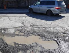 A pond-sized pothole is located at the intersection of Elm Street and Frood Road on March 11. (John Lappa/Sudbury Star)