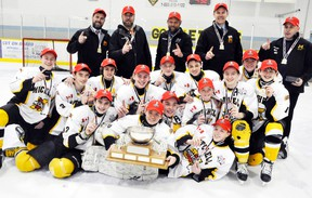 The Mitchell Bantams captured the 2015-16 Ontario Minor Hockey Association (OMHA) 'CC' championship on home ice last Saturday, March 19 with a 4-3 win over Bancroft in Game 3 of their best-of-five series. Team members are (back row, left to right): Scott MacLean (assistant coach), Joe Schoonderwoerd (coach), Colin Weir (manager), Chris Vogels (trainer) and Jody Catalan (trainer). Middle row (left): Tyler Roobroeck, Declan Catalan, Ryan Harmer, Calvin McCorkindale, Jacob Rauser, Connor Weir and Jarett Vogels. Front row (left): Drew MacLean, Zach Dow, Carter Schoonderwoerd, Jackson MacArthur, Reid Ramseyer, Eric Gettler and lying on ice is goalie James Copeland.  ANDY BADER/MITCHELL ADVOCATE