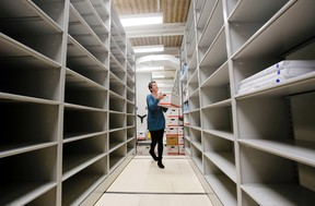 Luke Hendry/The Intelligencer City archivist Amanda Hill begins the long task of placing boxes of records on the shelves of the new Community Archives of Belleville and Hastings County Monday. The facility is to open in mid-April.