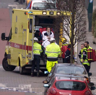 A woman is evacuated in an ambulance by emergency services after a explosion in a main metro station in Brussels on March 22, 2016. (AP Photo/Virginia Mayo)