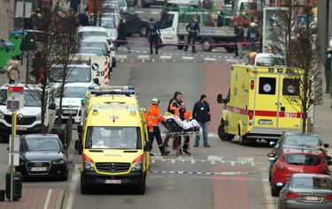 A victim is evacuated on a stretcher by emergency services after a explosion in a main metro station in Brussels on March 22, 2016. (AP Photo/Virginia Mayo)