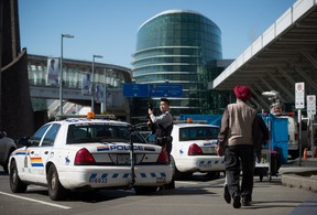 An RCMP officer patrolling the departures area at Vancouver International Airport in Richmond, B.C., on Tuesday March 22, 2016. Officials said security at the airport has been heightened after the attack on the Brussels airport in Belgium. (THE CANADIAN PRESS/Darryl Dyck)