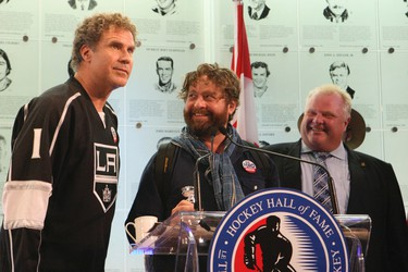 19TORCampaign31--Actors Will Ferrell and Zach Galifianakis promote  'The Campaign' and  pose with miniature Stanley Cups presented to them by Mayor Rob Ford at Toronto's  Hockey Hall Of Fame, on Yonge Street on July 30 , 2012.  Stan Behal/Toronto Sun/QMI Agency