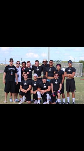 Members of the Recruit Ready crew from Winnipeg pose with Carolina Panthers quarterback Cam Newton at the national championship in Florida in 2014.
