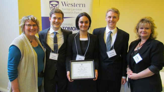Winners of this year's Capstone design project competition were named at the Western Sarnia-Lambton Research Park Thursday March 24, 2016 in Sarnia, Ont. Students in their final year of Western University's chemical and biochemical engineering program prepared projects and competed for prize money provided by industry sponsors. From left, Julianne Pohlner of Worley Parsons, and members of one of the winning teams, Mark Pipher, Erica Glatt, and Clifford Palmer, with Janice McMichael Dennis of Bluewater Power.