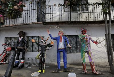 An effigy of U.S. Republican presidential hopeful Donald Trump (2nd R) is seen next to other figures outside a workshop before them were burned during an Easter ritual late on Saturday in Mexico City's poor La Merced neighborhood March 26, 2016.  REUTERS/Henry Romero