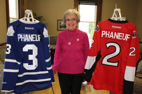Volunteer Wilma McNeill displays a pair of autographed Dion Phaneuf jerseys set to be raffled off in support of St. Joseph's Hospice. McNeill, who is Phaneuf's great-aunt, has been organizing the annual jersey raffle for the last six years. Close to $20,000 has been raised for the hospice over the last five years.  Barbara Simpson/Sarnia Observer/Postmedia Network