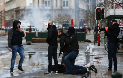 A right wing demonstrator is detained by police following a protest at the site of one of the memorials to the victims of the recent Brussels attacks, near the Place de la Bourse in Brussels, Sunday, March, 27, 2016. (AP Photo/Alastair Grant)