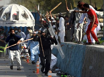 Pakistani protesters beat a paramilitary soldier during clashes near the parliament building in Islamabad, Sunday, March 27, 2016.  (AP Photo/Anjum Naveed)