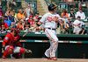 Baltimore Orioles' Chris Davis follows through on a solo home run swing off a pitch from Boston Red Sox's Roenis Elias as catcher Sandy Leon watches in the sixth inning of a spring training baseball game, Saturday, March 26, 2016, in Sarasota, Fla. (AP Photo/Tony Gutierrez)