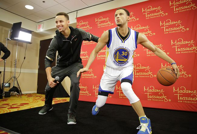 Which is the real Stephen Curry, which is the Madame Tussauds wax figure? (AP Photo/Eric Risberg)