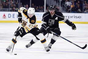 Bruins defenceman Torey Krug (left) moves the puck down the ice in front of Kings centre Anze Kopitar (right) during third period NHL action in Los Angeles on March 19, 2016. (Kelvin Kuo/USA TODAY Sports)