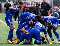 Pile of FC Edmonton players