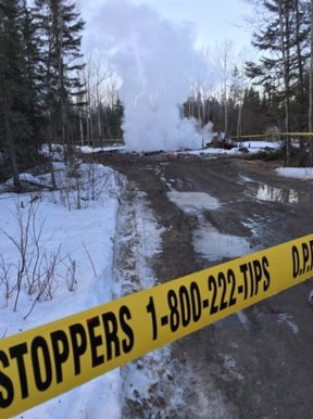 Police tape marks off a smouldering house on the Pikangikum First Nation, Wednesday, March 30, 2016. Nine people are believed to have died in a house fire on Pikangikum First Nation, says the member of Parliament for the riding that includes the northwestern Ontario community. THE CANADIAN PRESS/HO-Kyle Peters