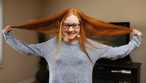 Calista Verkerk shows off her long ginger tresses in her home in Kingston, Ont. on Wednesday March 30, 2016. The 12-year old has been raising money and awareness in preparation to get her hair cut on Friday and donating it to Angel Hair For Kids to make hairpieces for kids in need. Julia McKay/The Whig-Standard/Postmedia Network