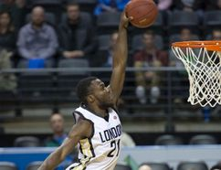Stephen Maxwell, shown here soaring over Orangeville A's player Lewis Jackson in a recent game, led London Lightning to a win over Windsor in the final regular-season game of the year Saturday night. Maxwell had 24 points and 15 rebounds. The A's return to Budweiser Gardens Monday for the teams' first playoff game. (Derek Ruttan/London Free Press)