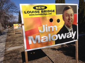 """The sticker says """"New Louise Bridge"""" and includes a website where people can get more information about why plans to replace the bridge have been put on hold by city hall."""