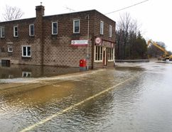 Water is seen over Highway 6 in Williamsford on April 1. (James Masters The Sun Times)