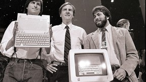 In this April 24, 1984, file photo, Steve Jobs, left, chairman of Apple Computers, John Sculley, centre, president and CEO, and Steve Wozniak, co-founder of Apple, unveil the new Apple IIc computer in San Francisco. (AP Photo/Sal Veder, File)