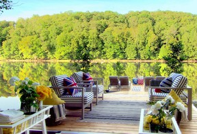 Carefully attired with contemporary outdoor furniture and jaunty toss pillows, the dock provides a cosy retreat.