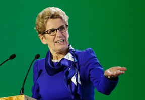 Ontario Premier Kathleen Wynne, delivers her speech during a signing ceremony at the COP21, the United Nations Climate Change Conference on Dec. 7, 2015 in Le Bourget, north of Paris.  (AP Photo/Christophe Ena)