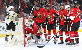 Dejected Senators look on as Pittsburgh Penguins' Nick Bonino celebrates a goal by the visitors at the Canadian Tire Centre. (Jean Levac, Postmedia Network)