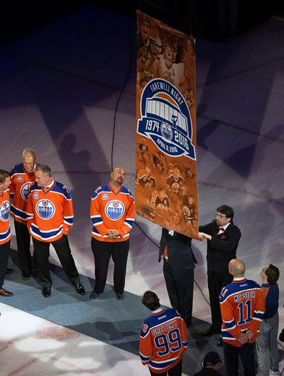 The farewell banner is lowered from the rafters during the a farewell ceremony, following the final NHL game at Rexall Place, in Edmonton Alta. on Wednesday April 6, 2016. Photo by David Bloom