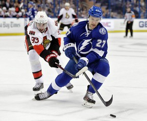Tampa Bay Lightning left wing Jonathan Drouin loses the puck to a stick-check by Ottawa Senators center Mika Zibanejad during first-period NHL action in Tampa, Fla., on Dec. 10, 2015. (THE CANADIAN PRESS/AP/Chris O'Meara)