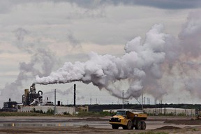 A dump truck works near the Syncrude oil sands extraction facility near the city of Fort McMurray, Alta., on June 1, 2014. (THE CANADIAN PRESS/Jason Franson)