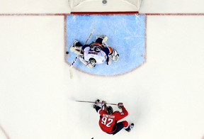 New York Islanders goalie Christopher Gibson blocks a shot by Washington Capitals centre Evgeny Kuznetsov in the overtime period of a game in Washington on April 5, 2016. (AP Photo/Alex Brandon)