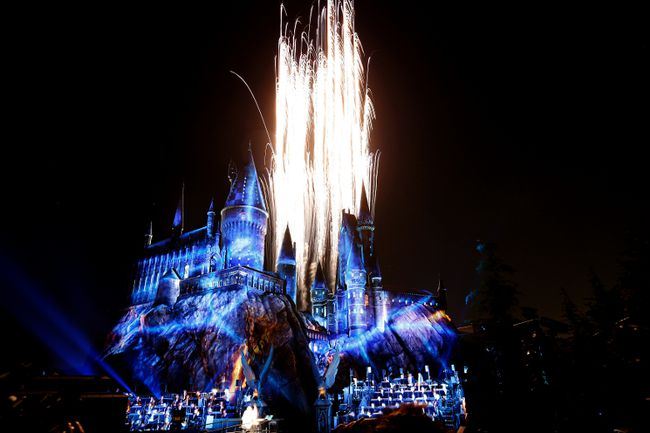 """Fireworks explode over a reproduction of Hogwarts Castle, as the Los Angeles Philharmonic performs conducted by composer John Williams, during a special preview opening of """"The Wizarding World of Harry Potter"""" attraction at Universal Studios Hollywood in Universal City, California April 5, 2016.   REUTERS/Mario Anzuoni"""
