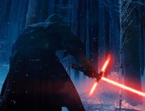 """This photo provided by Disney shows, Adam Driver as Kylo Ren with his Lightsaber in a scene from """"Star Wars: The Force Awakens."""""""