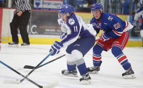 Sudbury Wolves Alan Lyszczarczyk skates past Kitchener Rangers Nick Magyar during OHL action from the Sudbury Community Arena in Sudbury, Ont. on Friday October 2, 2015. Lyszczarczyk is coming off a strong showing with Team Poland at IIHF U18 championships. Gino Donato/Sudbury Star/Postmedia Network