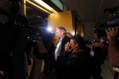 Federal NDP leader Thomas Mulcair (centre) arrives with his partner Catherine Pinhas for his speech during the Edmonton 2016 NDP national convention at Shaw Conference Centre in Edmonton, Alta., on Sunday April 10, 2016. Mulcair faces a leadership vote at the convention. Photo by Ian Kucerak