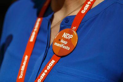 Former MP Megan Leslie speaks, wearing a supportive button, for the Leap Manifesto during the Edmonton 2016 NDP national convention at Shaw Conference Centre in Edmonton, Alta., on Sunday April 10, 2016. The climate change manifesto passed. Photo by Ian Kucerak