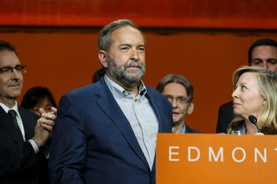 Federal NDP leader Thomas Mulcair (centre) gives a concession speech after the party voted for a leadership review during the Edmonton 2016 NDP national convention at Shaw Conference Centre in Edmonton, Alta., on Sunday April 10, 2016. Photo by Ian Kucerak