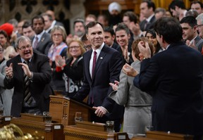 Minister of Finance Bill Morneau is given a standing ovation as he arrives to deliver the federal budget in the House of Commons on Parliament Hill in Ottawa on March 22, 2016. THE CANADIAN PRESS/Adrian Wyld