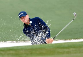 Davis Love III hits out of a bunker on the 2nd hole during the final round of the 2016 The Masters golf tournament at Augusta National Golf Club. Mandatory Credit: Michael Madrid-USA TODAY Sports