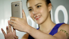 A model poses for photographs with HTC 10, an Android-based smartphone, during its launch event in Taitung, Taiwan April 12, 2016. REUTERS/Tyrone Siu