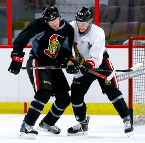 Senators defenceman Dion Phaneuf (left) battles with teammate Ryan Dzingel (right) during practice at the Canadian Tire Centre on March 14, 2016. (Errol McGihon/Ottawa Sun)