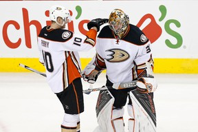 Anaheim Ducks goalie Frederik Andersen (31) celebrates with Ducks right wing Corey Perry (10) after their game against the Washington Capitals at Verizon Center. The Ducks won 2-0.