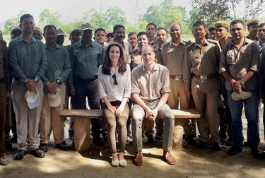 Britain's Prince William and his wife Catherine, the Duchess of Cambridge, pose with forest officials inside Kaziranga National Park in the northeastern state of Assam, India, April 13, 2016. REUTERS/Pool