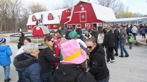 Families are shown in this file photo lining up for train rides at the Children's Animal Farm in Canatara Park during this year's Easter in the Park. The popular animal farm recently received a $3,860 donation, raised by Sarnia mother Chloe Dennis during a second annual online auction she organized. (File photo/Sarnia Observer/Postmedia Network)