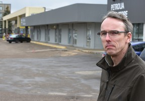 Ian Hicks, heading up an advocacy group that wants to see the Petrolia Mall revitalized and is frustrated that a lease held by Loblaws doesn't allow a potential restaurateur to develop the old mechanic building in Edmonton, April 13, 2016. (ED KAISER/PHOTOGRAPHER)