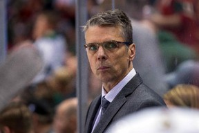 Ottawa Senators head coach Dave Cameron watches his team in the third period against the Minnesota Wild in Minneapolis, in this file photo taken March 31, 2016. (Brad Rempel/USA TODAY Sports)
